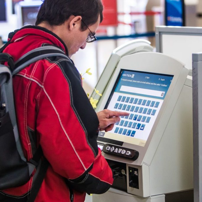 Man using airline check-in kiosk